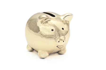 Golden piggy bank isolated on white background with copy space.
