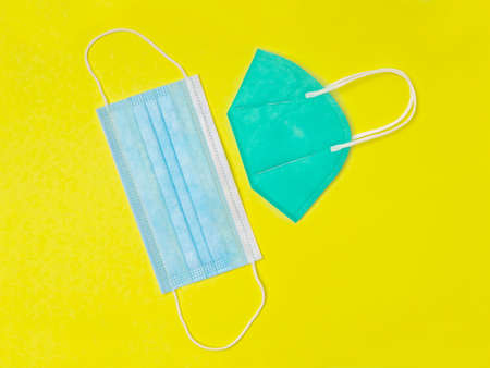 Different face masks on yellow background.