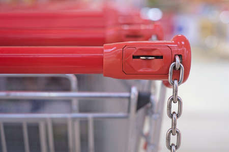 Closeup of a shopping trolley locking system. Horizontal image with soft focus.