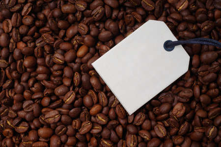 Top view of a bunch of roasted coffee beans. Horizontal image with label for your individual text.