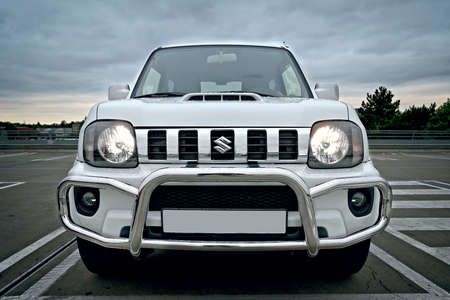 Neu-Ulm, Bavaria, Germany - August, 21, 2021: Suzuki Jimny FJ 4x4 vehicle in urban environment. Front view of the car with headlights on. Editorial