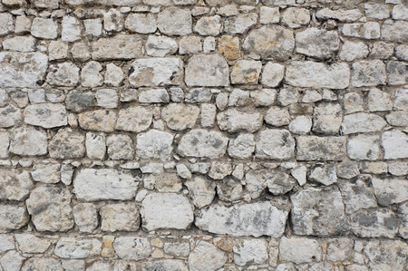 varying: old castle or fortress stone wall made of white and gray stone blocks