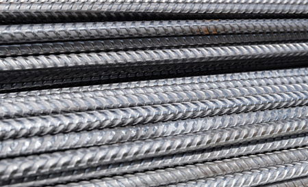 horizontally aligned division rebar - steel rods from a construction site