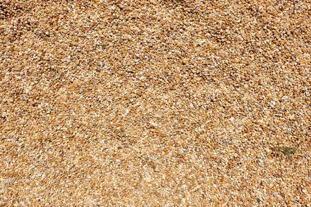 gravel  aggregate pattern - small yellow, orange and white stones