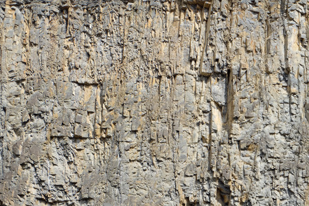 rock face  cliff at a quarry - irregular stone pattern Stock fotó