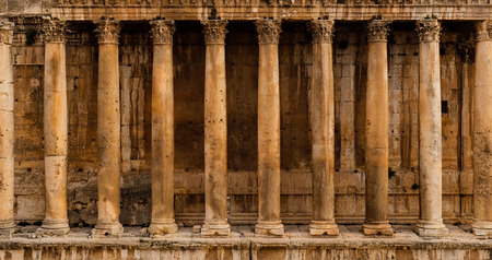 Frontal view of a colonnade - Row of columns of an ancient Roman temple ruin (Bacchus temple in Baalbek) Stock Photo
