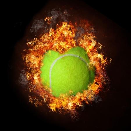 Tennis ball on fire Stock Photo