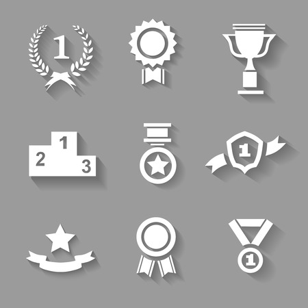 accomplishments: Set of white  award  success and victory icons with trophies  stars  cups  ribbons  rosettes  medals medallions  wreath and a podium on grey