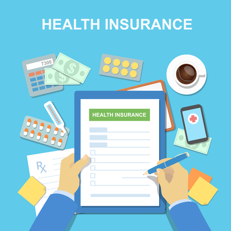 medical bills: Man at the table fills in the form of health insurance