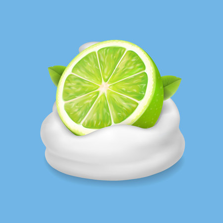 Lime slice in yogurt or whipped cream splash isolated. Natural dairy products
