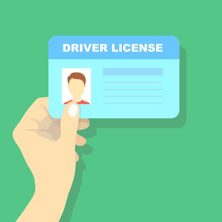 Mano che tiene la patente di guida dell'auto, carta d'identità