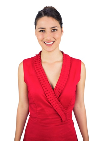 Smiling sexy tied haired brunette in red dress posing on white background photo