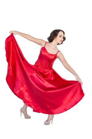 Gorgeous woman dancing flamenco on white background  photo