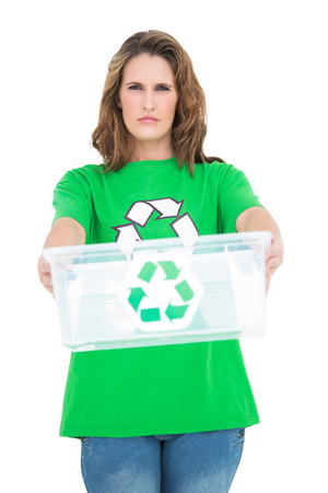 activist: Serious environmental activist holding recycling box on white background