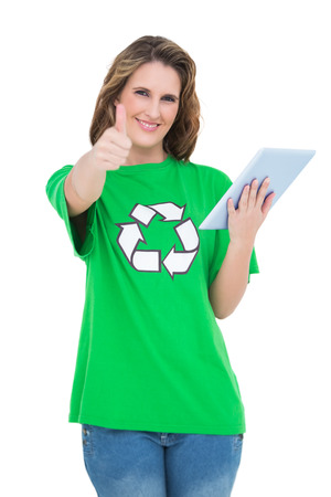 Happy environmental activist giving thumbs up holding tablet against white background photo