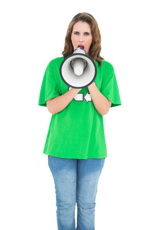 Attractive environmental activist screaming in a megaphone on white background photo