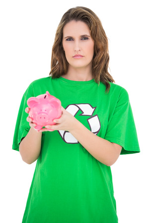Young activist showing her piggy bank on white background photo