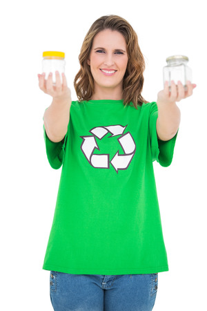 activist: Smiling environmental activist showing pots looking at camera on white background