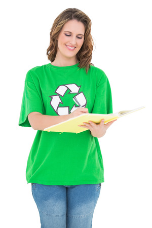 woman looking down: Happy environmental activist holding notebook against white background