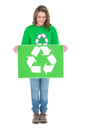 activist: Happy environmental activist holding recycling sign on white background