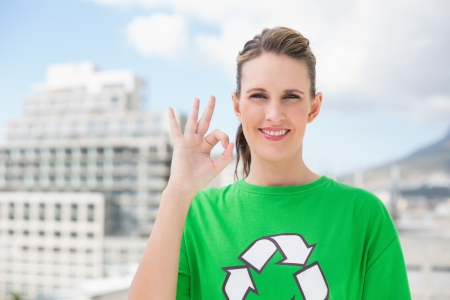 activist: Cheerful environmental activist making okay gesture outside on a sunny day
