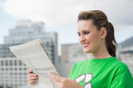 activist: Environmental activist reading newspaper and smiling