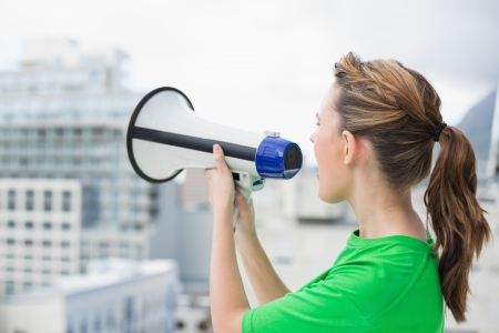 Side view of woman using and screaming in megaphone Stock Photo - 22324382