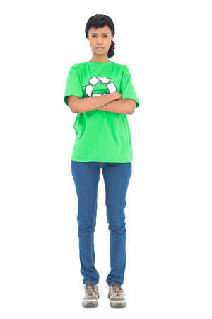 frowning: Frowning black haired ecologist posing with crossed arms on white background