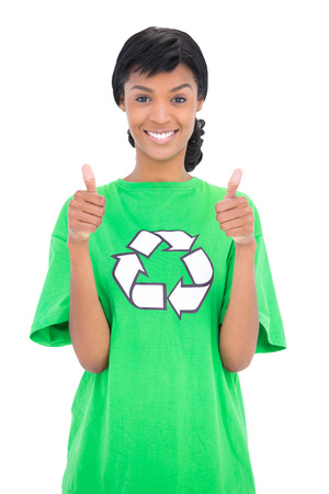ecologist: Cheerful black haired ecologist giving thumbs up on white background Stock Photo