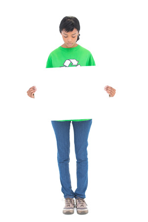 ecologist: Concentrated black haired ecologist holding a white panel in front of her on white background Stock Photo