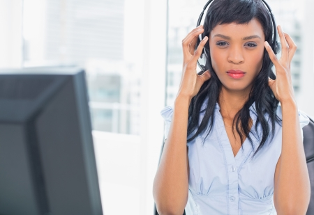 exasperated: Exasperated operator looking at camera in office Stock Photo