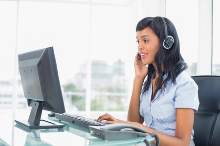 Concentrated operator answering a call in office Stock Photo