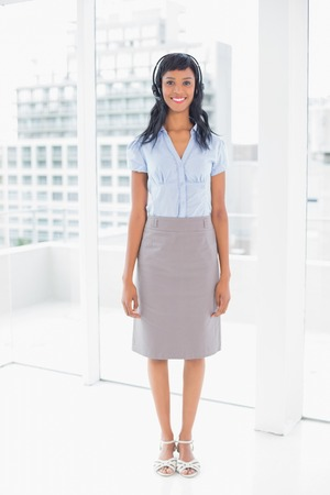 Beautiful operator smiling and looking at camera in office photo