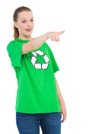 activist: Shocked pretty environmental activist pointing something with her finger on white background