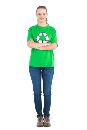activist: Pleased pretty environmental activist posing with crossed arms on white background Stock Photo