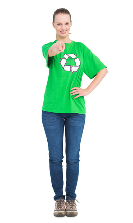 Content pretty environmental activist pointing the camera with her finger on white background Stock Photo - 22325103