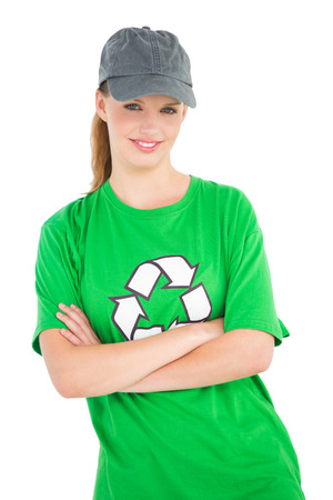 Calm pretty environmental activist posing with crossed arms on white background photo