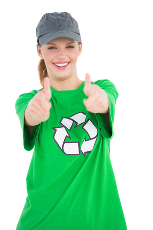Happy pretty environmental activist making thumbs up on white background photo