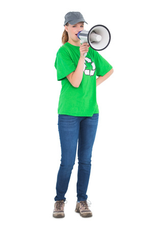 Dynamic pretty environmental activist yelling in a megaphone on white background photo
