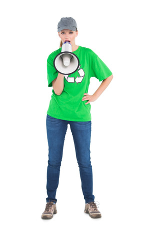 activist: Motivated pretty environmental activist yelling in a megaphone on white background