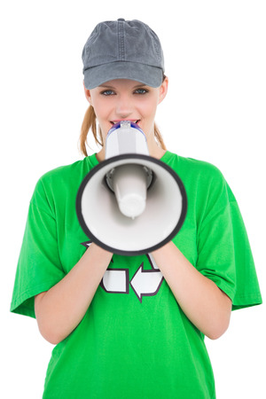 Amused pretty environmental activist speaking in a megaphone on white background photo