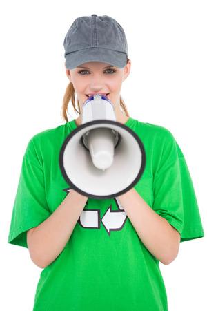 activist: Amused pretty environmental activist speaking in a megaphone on white background