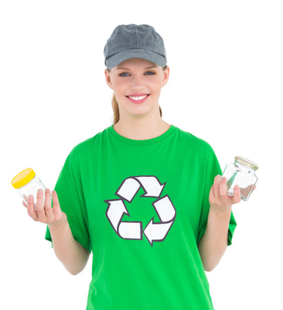 Dynamic pretty environmental activist holding two jars on white background photo