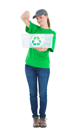 Happy pretty environmental activist showing a recycling box on white background photo