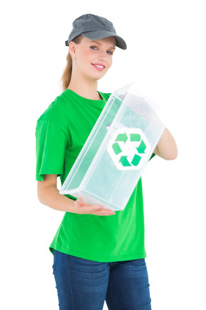 Cheerful pretty environmental activist holding a recycling box on white background photo