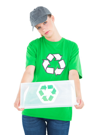 Stern pretty environmental activist holding an empty recycling box on white background photo