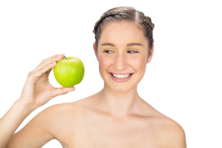 Smiling healthy model holding green apple on white background photo