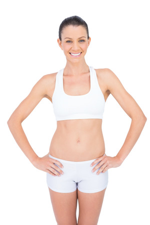 Smiling fit sportswoman posing on white background Stock Photo - 22327681