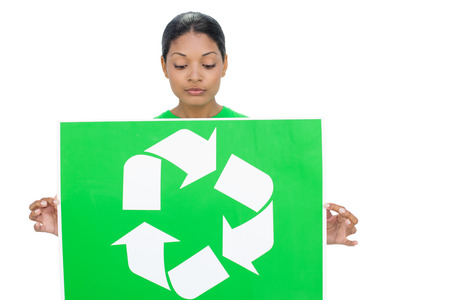 woman looking down: Content model holding recycling sign on white background