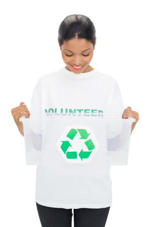 Happy model wearing volunteer tshirt holding recycling box on white background